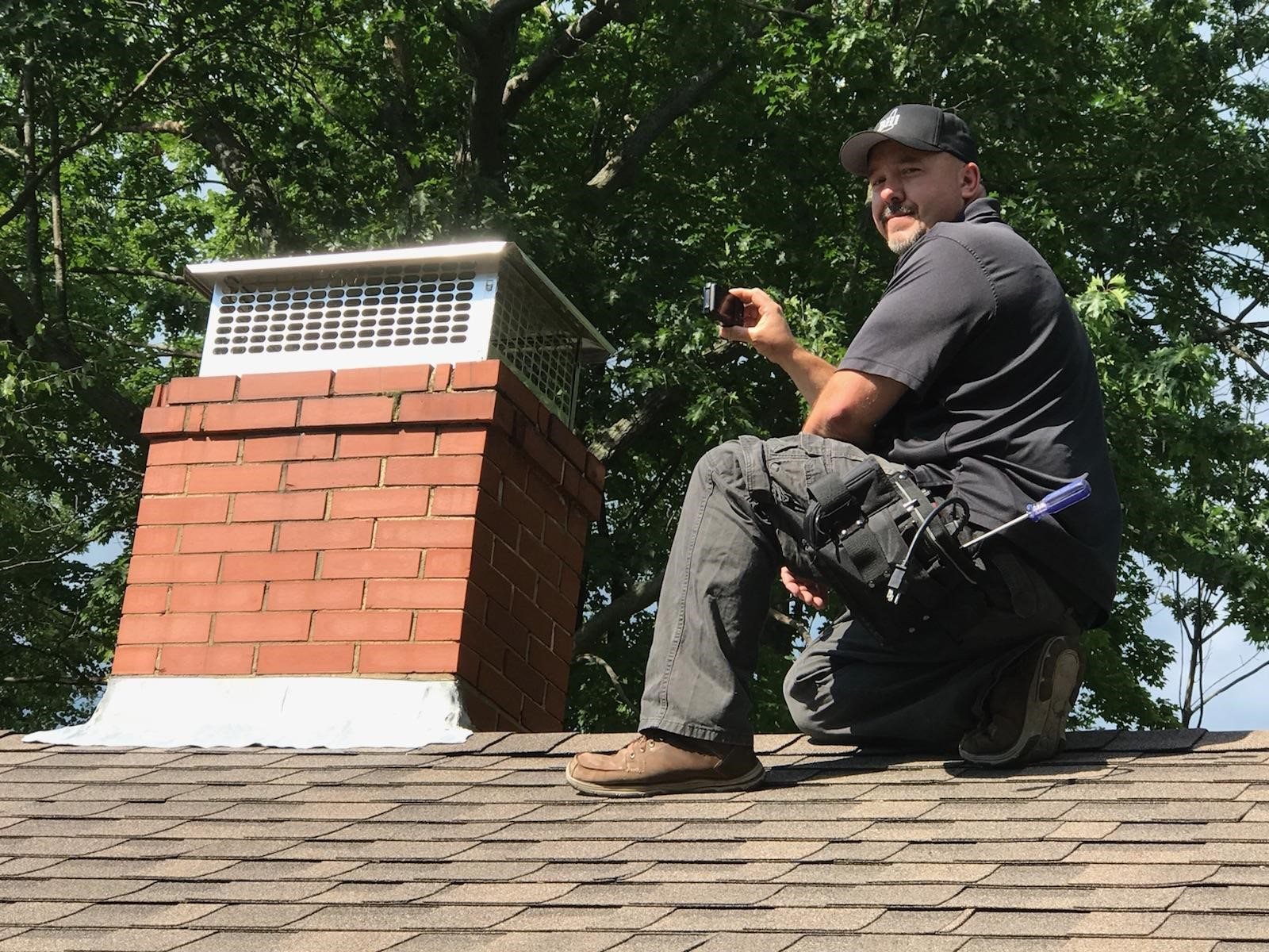 Craig Butler preforming a roof inspection